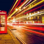 telephone telephone box by busy street at night